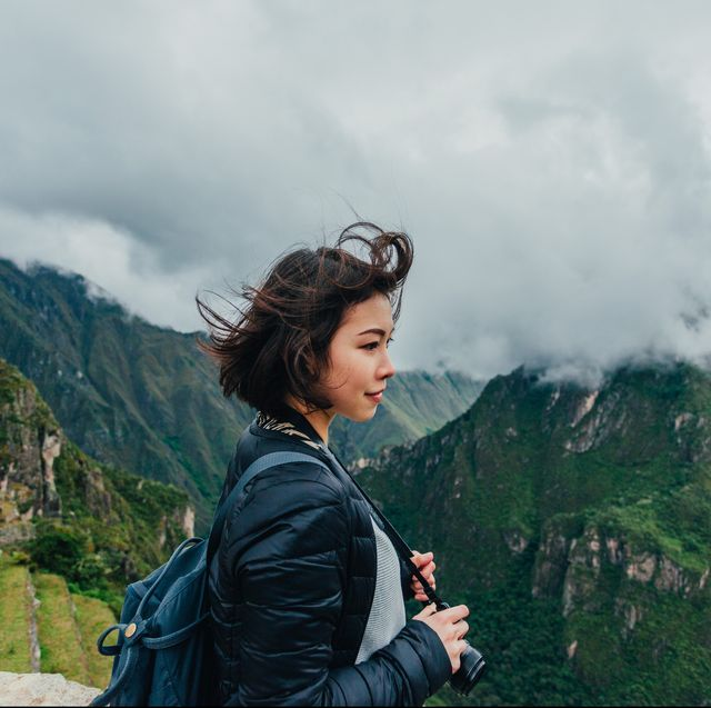 Young Woman Looking At View From Machu Picchu In Royalty Free Image 1609957894